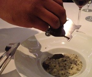 ..who then grates black truffle over a risotto