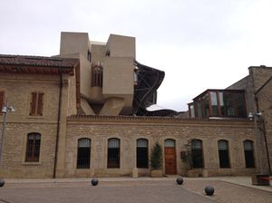 The ancient winery, with the new Gehry building centre rear