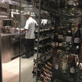 Looking through the hotel's glass-walled wine cellar