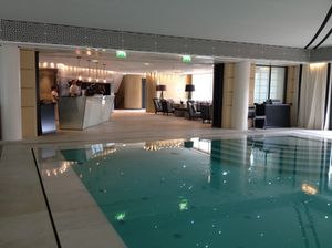 Inside, look across the pool to the kitchen