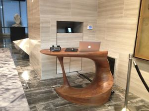 Through the front door, this is the desk you see