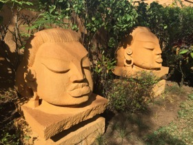 Mystic heads nestle variously in the grounds