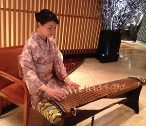 Kimono-clad hoko player