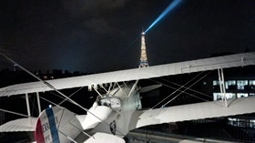 L'Oiseau Blanc, in front of the illuminated Eiffel Tower