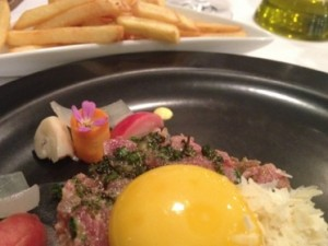 Beef tartare with an egg yolk