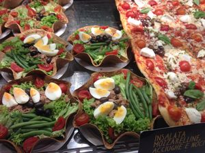 Salads and pizzas at a to-go stand
