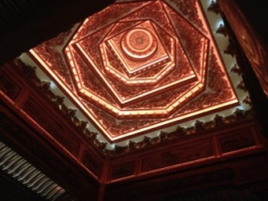 Looking up into the lobby's carved ceiling