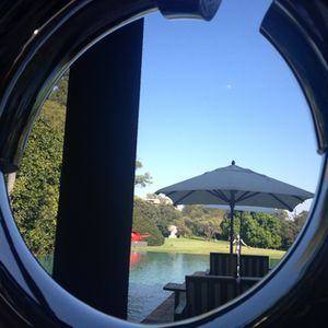 Look out, through a sculpture, across the front pool - at more sculpture