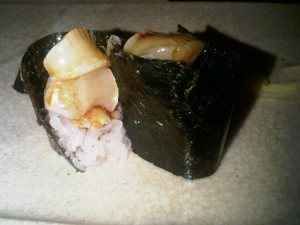 Sea-urchin sushi - the gal's cut into two, by Mr Brilliance, for more-delicate female eating