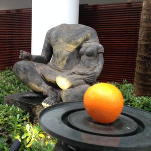 Statue, with real orange, by the spa