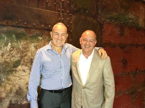 Backed by rusted ship panels, Bruce Ryde, left, and Christoph Zbinden