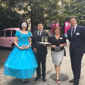 Invitation from a pink Langham taxi for Alison Gilmore, third left, and Nick Pilbeam, right