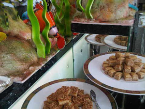 Local sweetmeats next to Shangri-La's lurid 'fish'