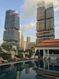 Looking across Raffles' rooftop pool at The South Beach