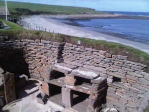 A look down into a section of a Skara Brae house (3,000 years BC), below ground with a driftwood and grass roof