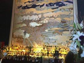 The bar has a typical-St Regis artwork behind the counter
