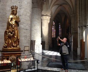 A sightseer summons energy to take a Cathedral photo