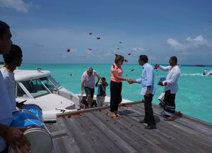Arrival at Taj Exotica, to drummers and red rose petals