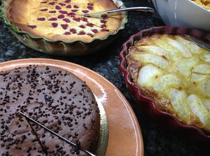 The scrumptious breakfast buffet includes a chocolate cake and big tarts