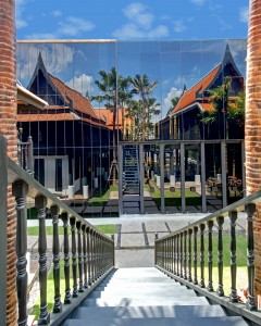 The hotel's old Thai houses are reflected in a 2012-vintage reflecting wall