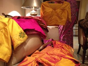 Some of Madame Leela's 200-plus saris are brought out…