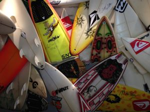 Broken sailboards behind front desk