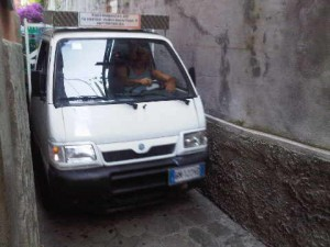 Truck negotiates the narrow streets of Positano