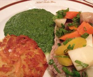 Boiled beef with vegetables, rösti and creamed spinach