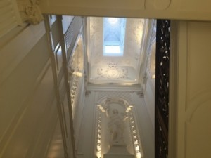 Looking up at the stairwell of the xxx House