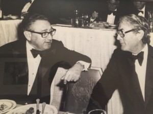 A meeting of classy glasses, H. Kissinger and G. Peck