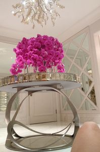 724's foyer's striking table holds fabulous orchids...