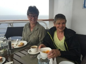 Ghastly weather, but two intrepid Brits find the tiniest dry spot for outdoor breakfast